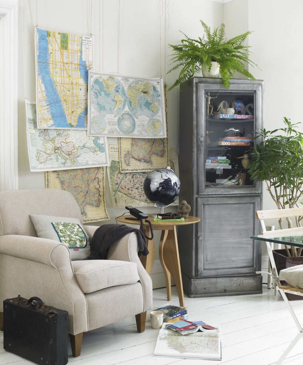 Living room with maps on a wall
