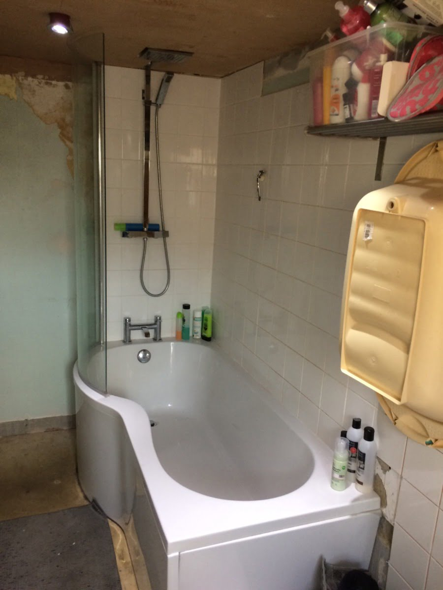 A before shot of the bath tub and room