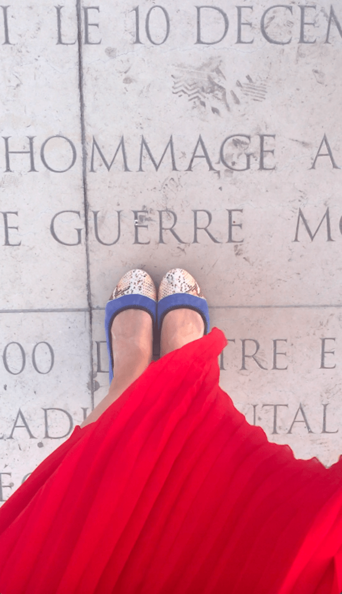 Maxine standing on a marble pavement in Paris