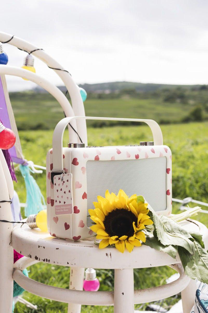 A love heart radio with a sunflower on a stool