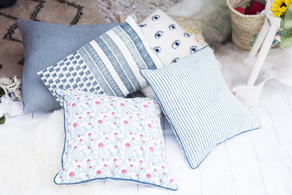 Some inviting looking cushions on a bed