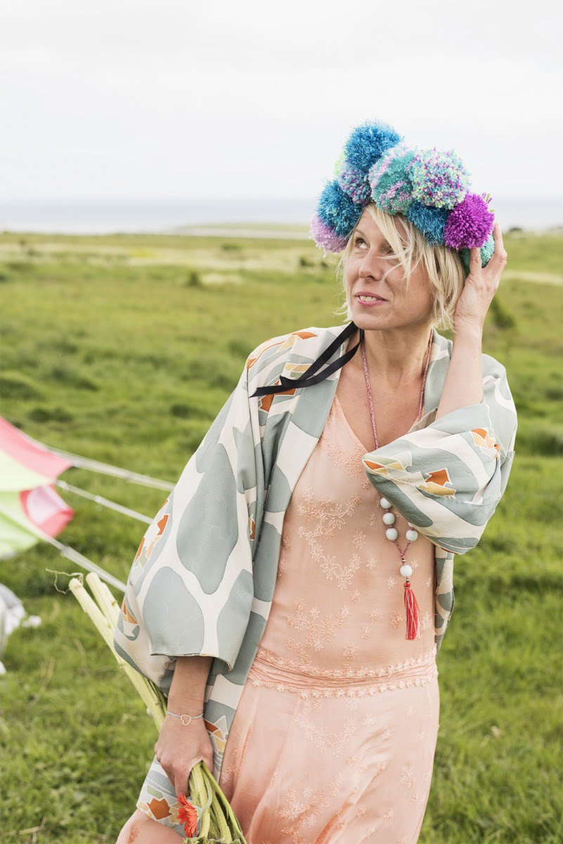 Maxine with a pom pom headdress