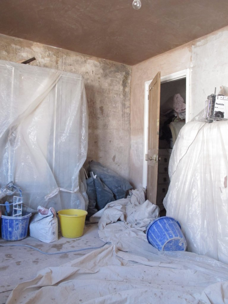 Guide to how to DIY your walls to get a distressed look by hacking off the plaster and treating it. It's cheap to do, looks brilliant and creates a real statement look in a home by interior stylist Maxine Brady.