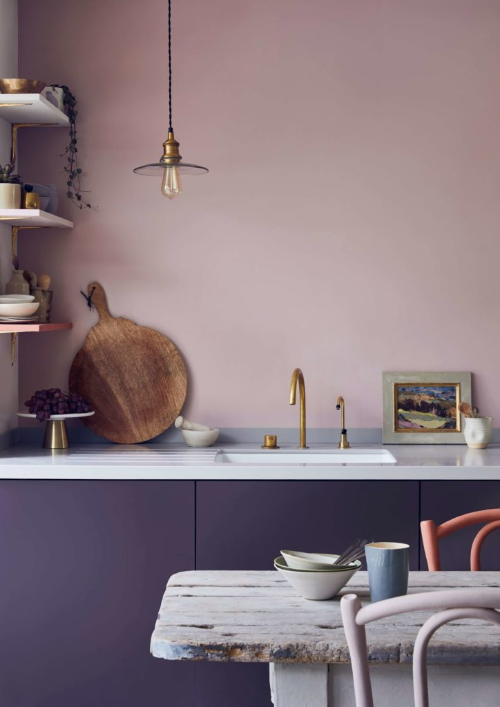 How to choose the perfect interior colour scheme for your home by interior stylist Maxine Brady from welovehomeblog.com Pinka nd lilac kitchen with rustic wooden table and blush painted chairs. Brass taps.