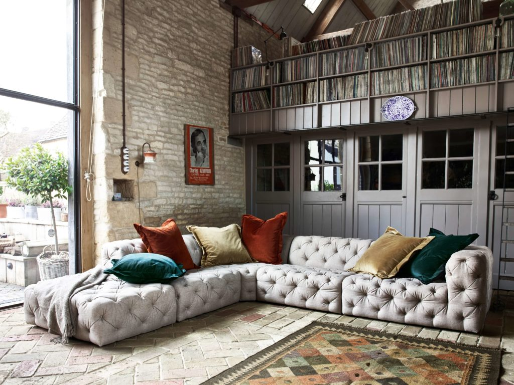 white chesterfield leather corner sofa large in barn home with crittal windows and record library