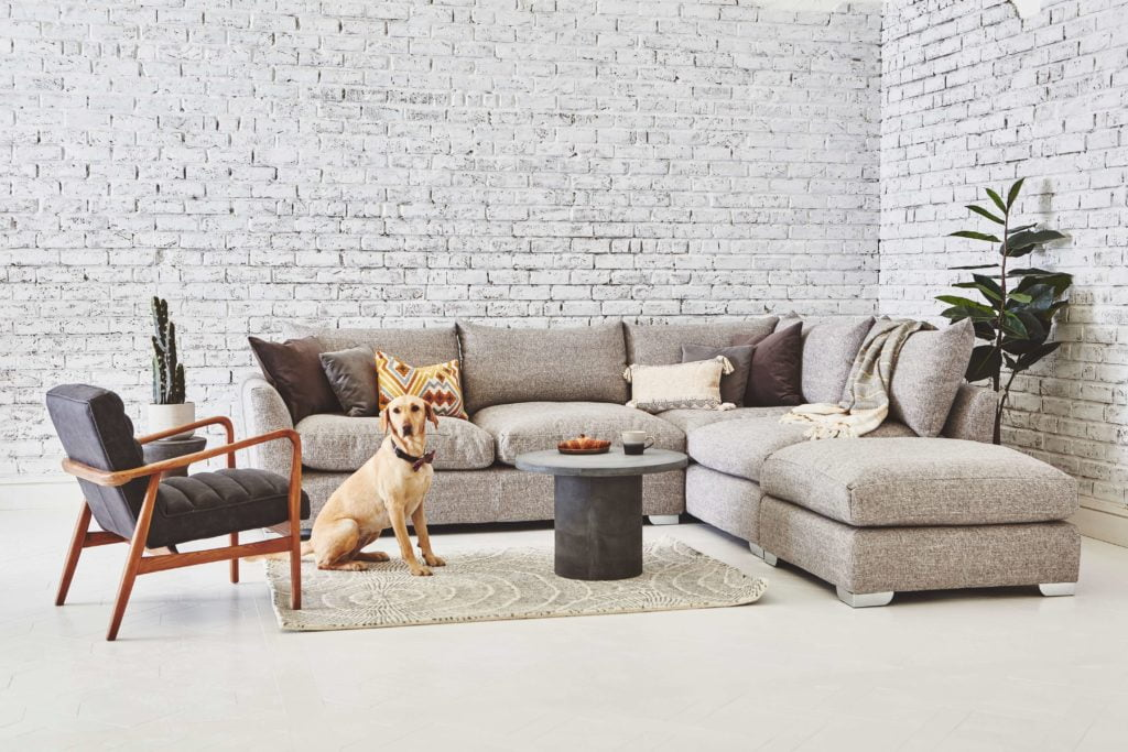 Discover these top 5 buyer's tips for buying a corner sofa by interior stylist and lifestyle blogger Maxine Brady from We Love Home Blog. white corner sofa with retro furniture in living room with brick wall