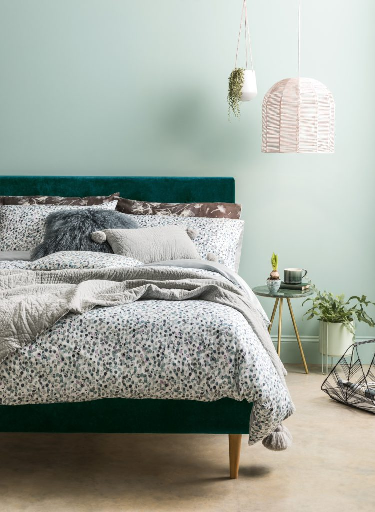 green bedroom with woolen throw and statement lighting and velvet bed Tips and tricks for styling your home with intention so that you can  create a space you'll love by interior stylist Maxine Brady from we love home blog