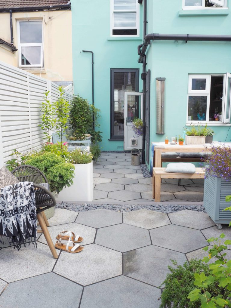 garden table, painted outdoor furniture, english garden. modern fencing, geometric paving