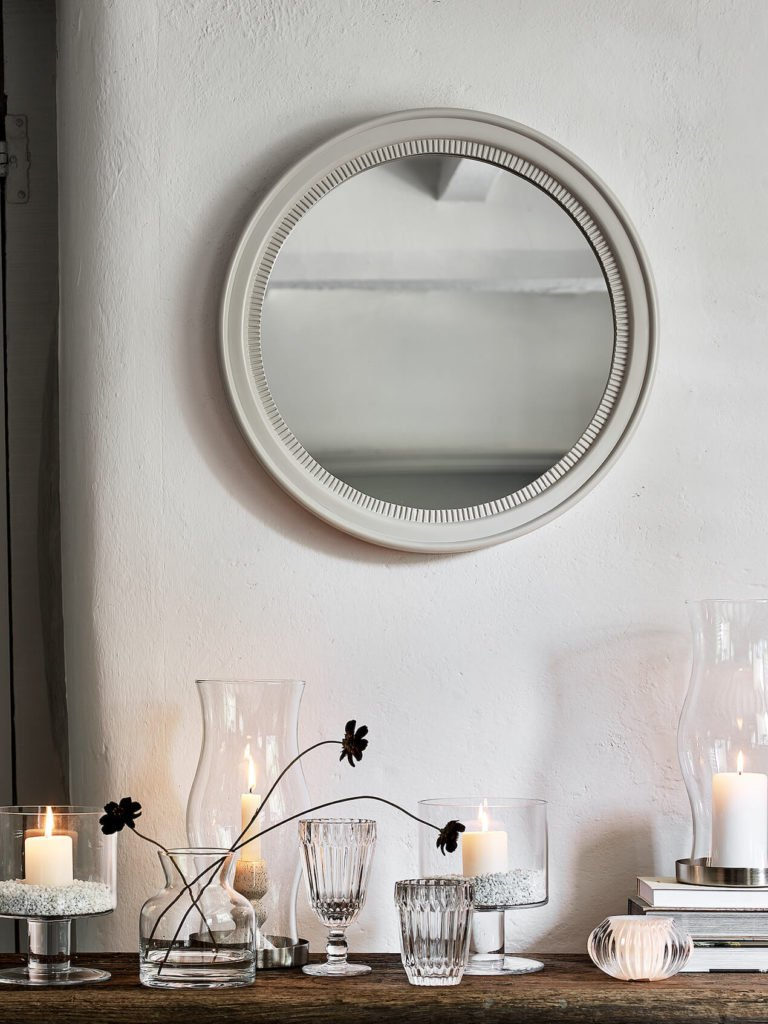 mirror nordic room with white walls and glass vases on shelf Winter styling