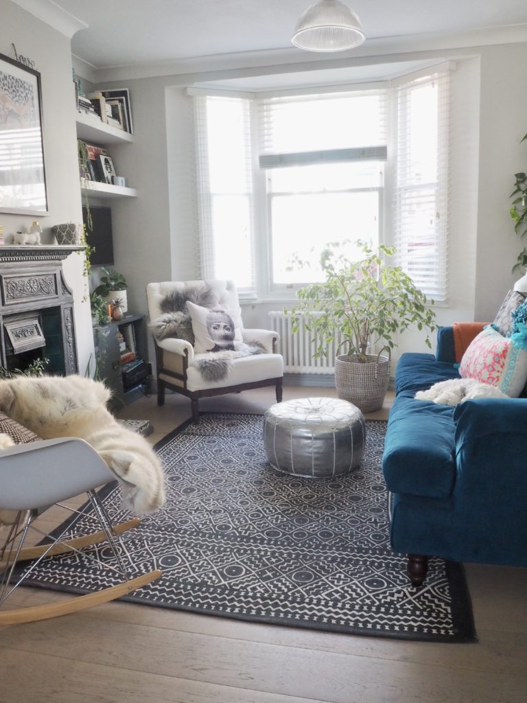 Follow these 5 key tips when buying your first home for a smooth purchase says interiors blogger Maxine Brady from We Love Home Blog modern boho living room with fur throws and teal velvet sofa