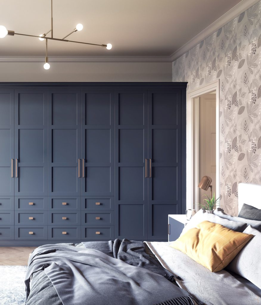 Be the first to see the plans for my bedroom makeover- (hint it has a coral wallpaper!) Blue fitted wardrobe with gold handles in bedroom