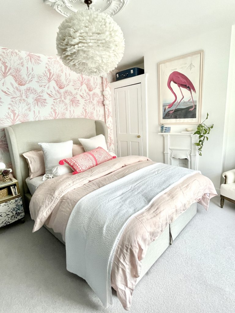 Step inside interior stylist Maxine Brady's cool bedroom redesign that is filled with clever storage ideas, pretty wallpaper and navy fitted wardrobes to create a dreamy room